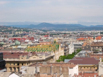 View across Budapest from St Stephens Basilica including colourful roof of the Art Nouveau Post Office Building