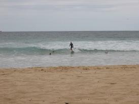 Catching a wave at Bondi Beach